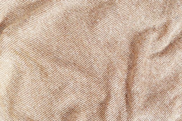 Fil de laine de texture tricotée beige. close-up en tissu de laine.