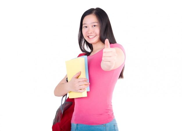 Fille étudiante debout et le pouce vers le haut sur fond blanc
