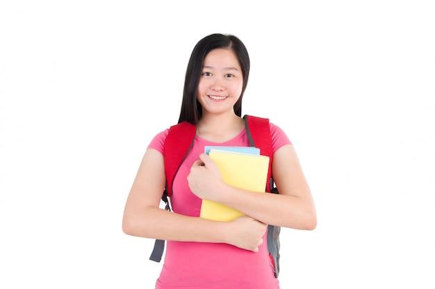 Fille jolie étudiante debout sur fond blanc
