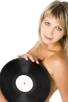 Fille sexy de beauté avec disque vinyle sur fond blanc