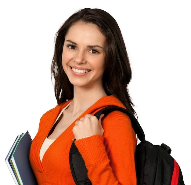 Fille sympathique avec sac à dos et bloc-notes - isolé