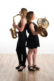Filles Jouant Des Instruments à Vent Photo Premium