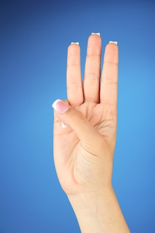Finger spelling the alphabet in american sign language (asl). lettre w