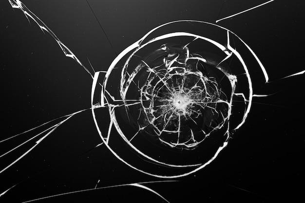 Fissures blanches rondes en verre sur fond noir.
