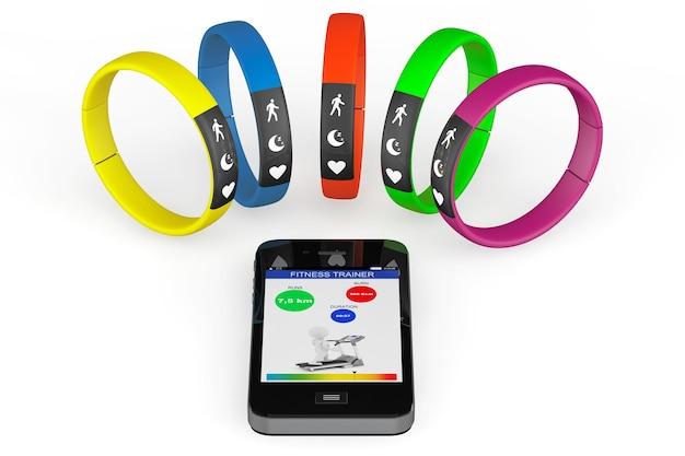 Fitness trackers avec téléphone mobile sur fond blanc