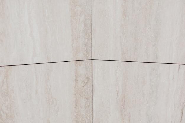 Fixé au mur brillant. marbre clair. texture de fond
