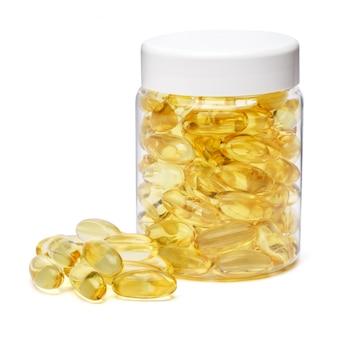 Flacon de médecine en plastique blanc peut pot avec des capsules sur blanc