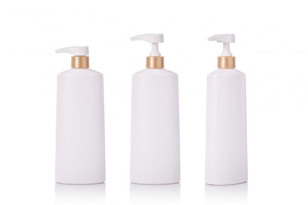 Flacon en plastique blanc contenant une pompe blanche utilisée pour le shampooing ou le savon.