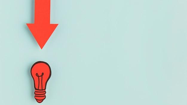 Flèche indiquant l'ampoule en papier