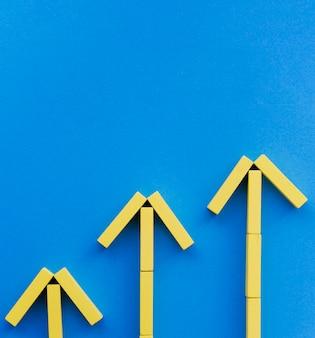 Flèches de bloc jaune pointant vers le haut