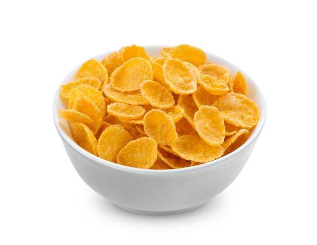 Flocons de maïs dans un bol isolé sur fond blanc