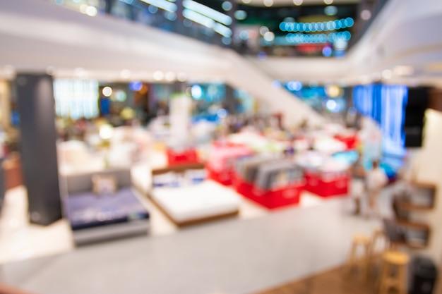 Flou abstrait avec bokeh et centre commercial défocalisé en magasin
