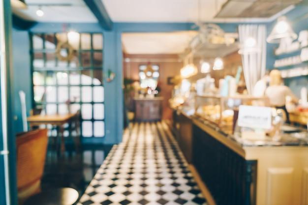 Flou abstrait et café-restaurant défocalisé pour le fond
