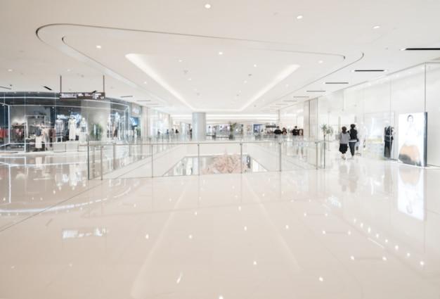 Flou abstrait et centre commercial défocalisé à l'intérieur d'un grand magasin pour le fond