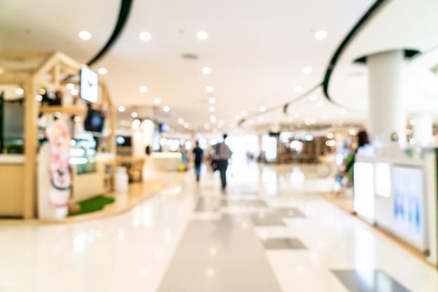Flou abstrait et centre commercial de luxe défocalisé et magasin de détail