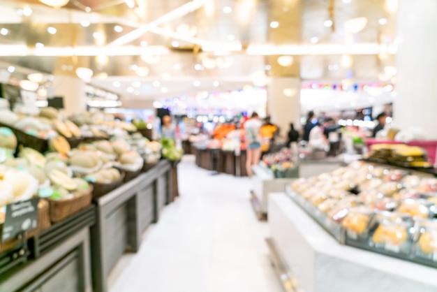 Flou abstrait dans un supermarché pour le fond