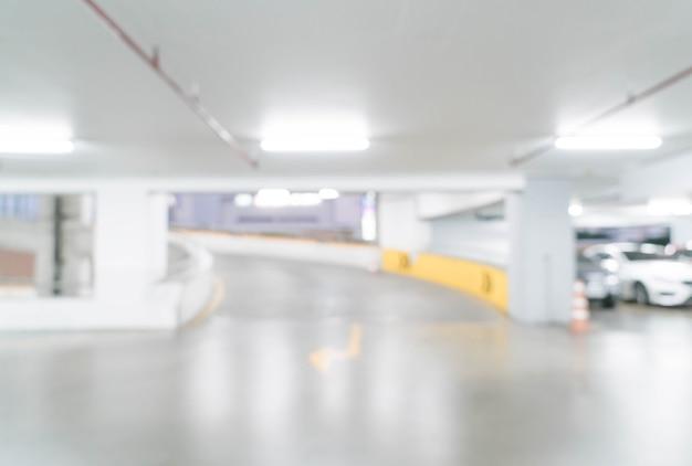 Flou abstrait dans la voiture de stationnement