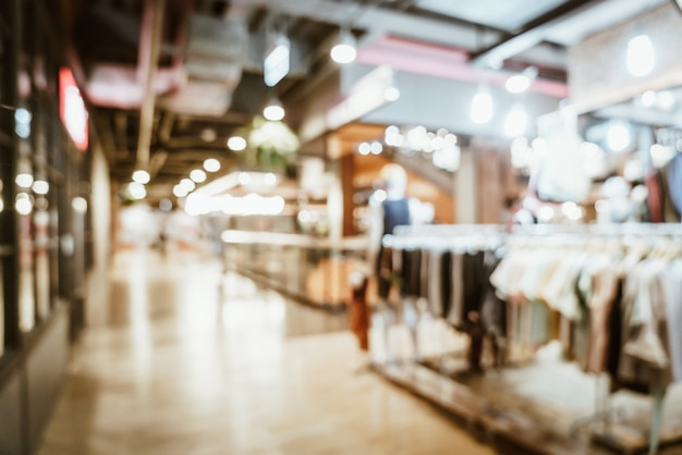 Flou abstrait et flou dans le centre commercial de luxe et magasin de détail pour le fond