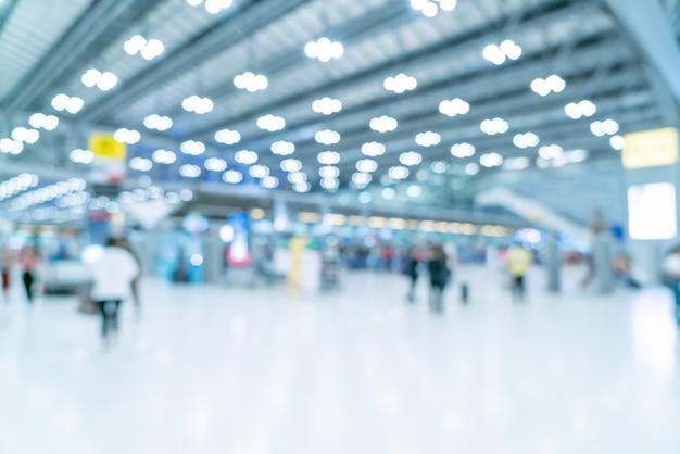 Flou abstrait et intérieur du terminal de l'aéroport défocalisé