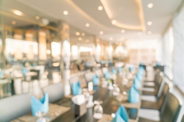 Flou abstrait et restaurant d'hôtel de luxe défocalisé pour le fond
