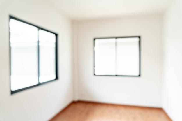 Flou abstrait salle vide avec fenêtre et porte à la maison