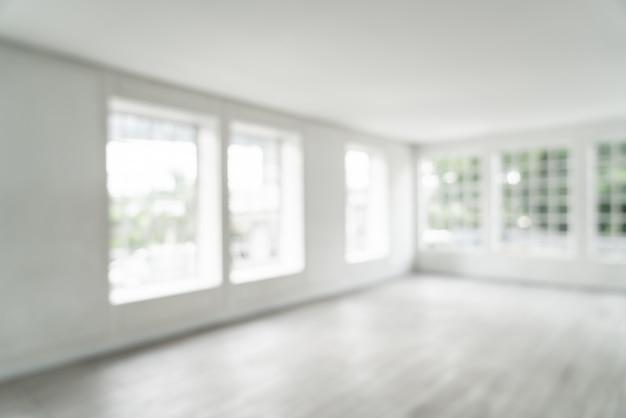 Flou abstrait salle vide avec fenêtre en verre