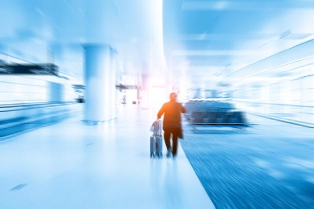 Flou dynamique de style bleu du passage du hall de départ