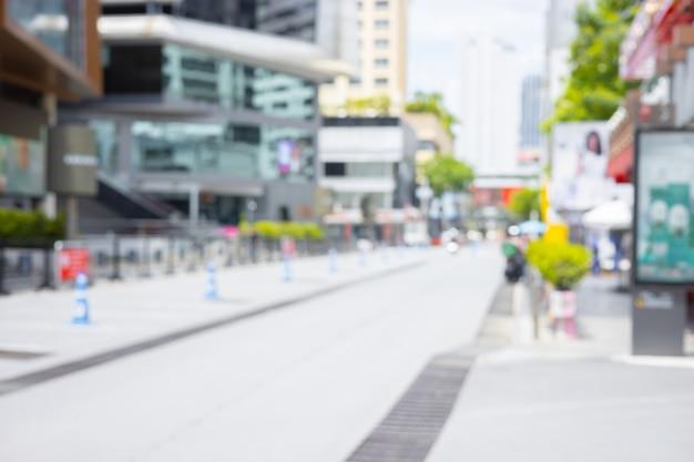 Flou de l'espace de marche public du métro de la ville lieu de la rue commerçante urbaine pour l'arrière-plan