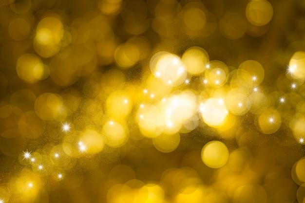 Fond abstrait bokeh de lumières dorées