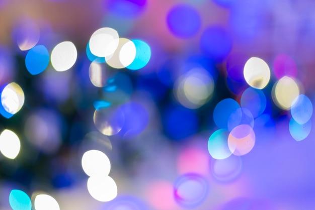 Fond abstrait élégant de fête bleu avec des lumières et des étoiles de bokeh