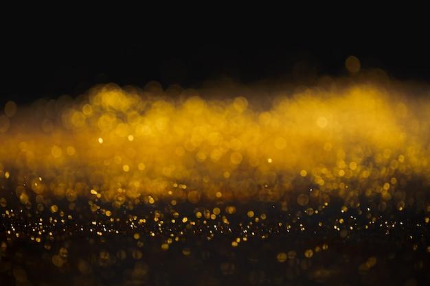 Fond abstrait élégant de paillettes d'or bokeh