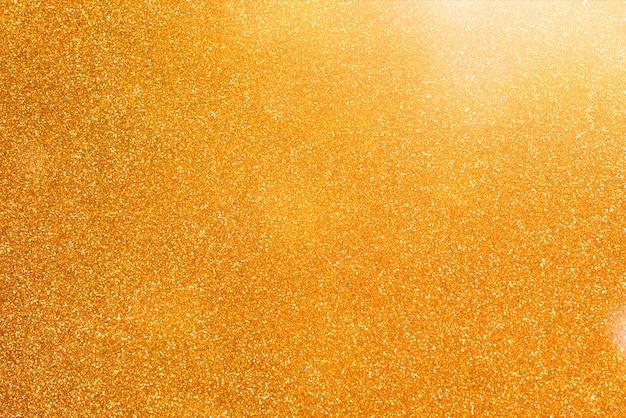 Fond abstrait de paillettes d'or.