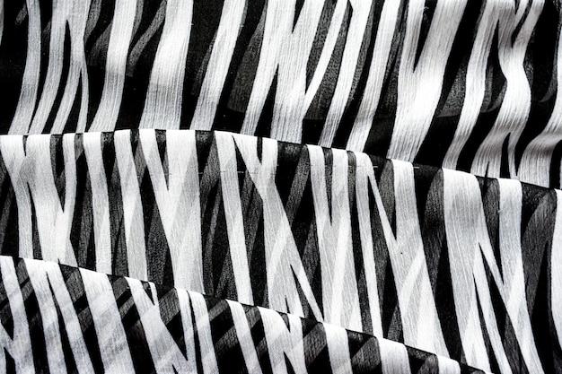 Fond abstrait à rayures noires et blanches