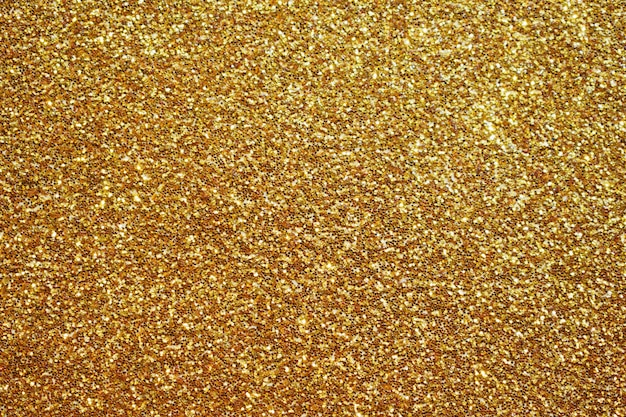 Fond abstrait scintillant de paillettes d'or