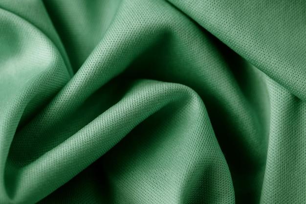 Fond abstrait textile vert. fermer