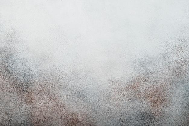 Fond abstrait. texture granuleuse tachetée. copier l'espace