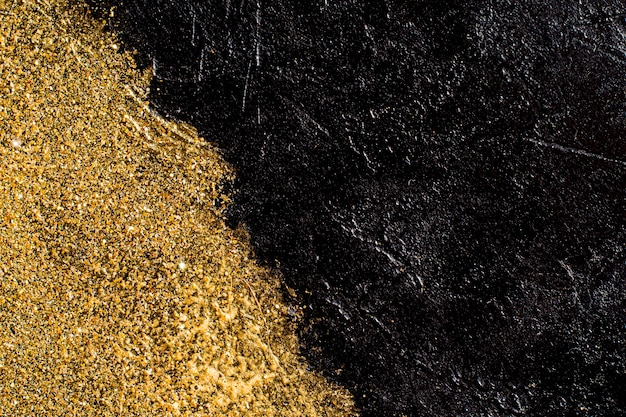 Fond d'ardoise avec des paillettes dorées