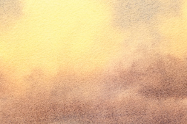 Fond d'art abstrait couleurs marron clair et jaune. peinture à l'aquarelle sur toile.