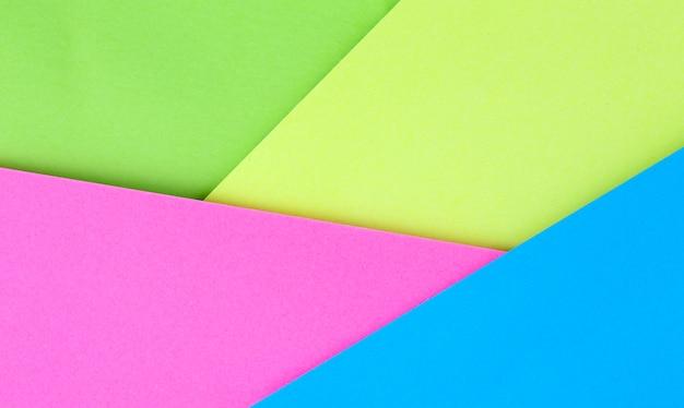 Fond d'autocollants colorés jaune, rose, bleu, vert