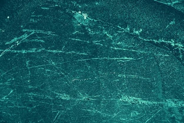 Fond azur vintage. mur peint brut de couleur turquoise. plan imparfait de couleur cyan. toile de fond décorative aux tons inégaux de teinte aqzure. texture de teinte turquoise. surface pierreuse ornementale.