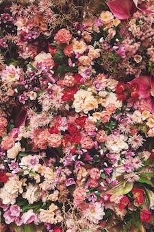 Fond avec beaucoup de belles fleurs différentes
