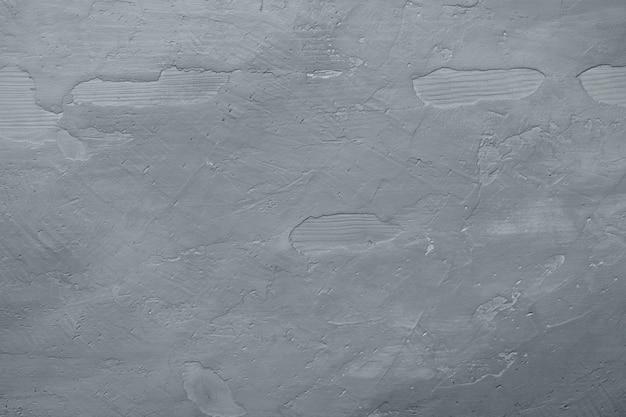 Fond en béton gris foncé. placoplâtre. mur gris