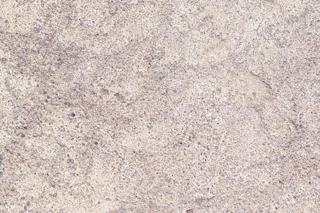 Fond de béton gris avec de petites inclusions