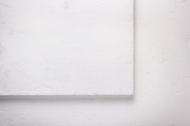 Fond blanc en bois ou mastic, texture de surface de mur ou de sol