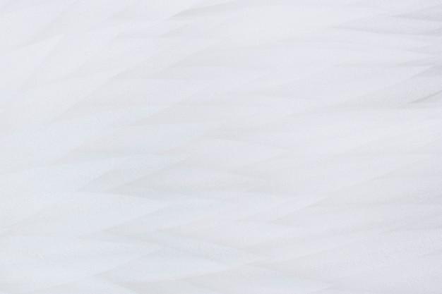 Fond blanc doux de plumes blanches, mise au point sélective douce, flou.