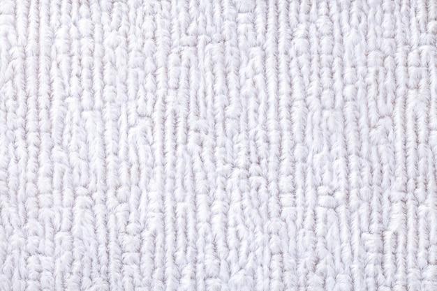 Fond blanc moelleux en tissu doux et moelleux. texture de textile agrandi