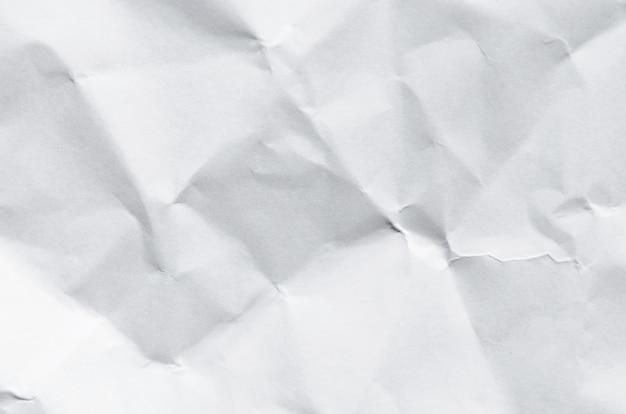 Fond blanc et papier peint par texture de papier froissé et espace libre.