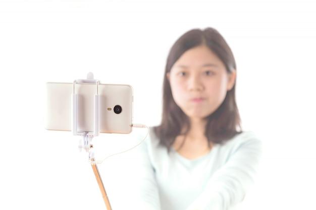 Fond blanc téléphone portable personne de sexe féminin
