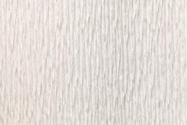 Fond blanc texturé de papier ondulé ondulé, gros plan.