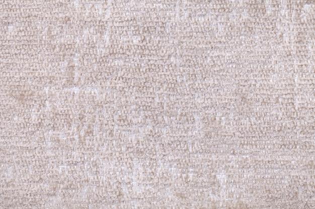 Fond blanc de tissu doux et moelleux. texture de textile agrandi
